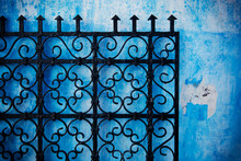 Metal Gate Against A Blue Wall...