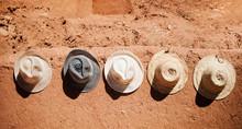 Hats Hanging Off A Stone Wall Merzouga Village, Morocco