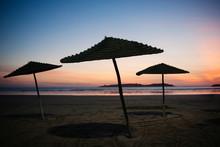 Umbrellas On The Beach At Suns...