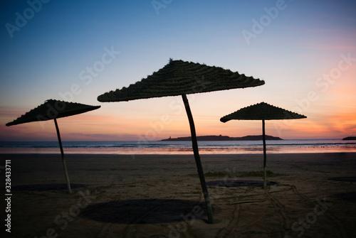 umbrellas on the beach at sunset Essaouira, Morocco  - 328433711