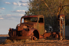 Abandoned Rusty Old Pick Up Truck Wreck Sits Derelict On The Side Of A Road On Sunset In The Australian Outback, Marree, South Australia