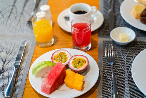 Fototapety, obrazy: Fresh romantic breakfast table next to morning briliant light window, with spaghetti, fruit, juice