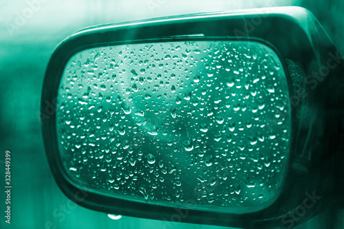 Side mirror of a car in raindrops Canvas Print
