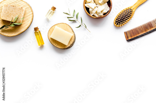 Obraz na plátně Cosmetics for hair care with argan and jojoba oil on white background top-down f