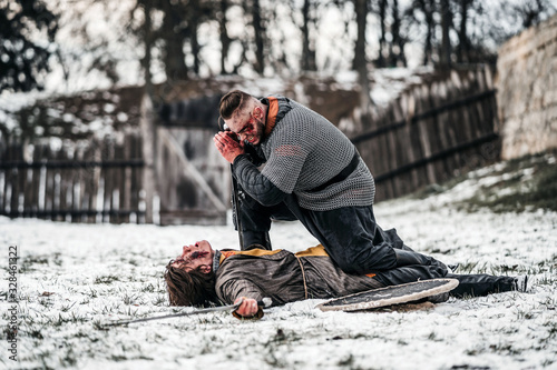 Photo The process of a medieval battle in the snow