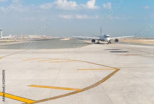 Commercial airliner on runway Wallpaper Mural