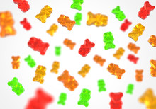 Jelly Gummy Bears Flying Candy Background. Fruit Gum Candies Theme. Red, Orange, Yellow And Green.