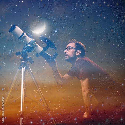 Amateur astronomer looking at the stars with a telescope Fotobehang