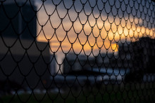 Chain Link Fence On A Sunset B...