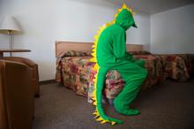 Lonely Dinosaur Man Sitting On...