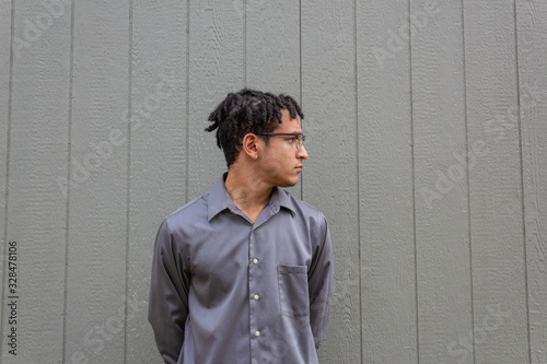 Black male with short dreads in profile view, ample copy space over neutral back Wallpaper Mural