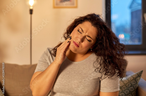 Stampa su Tela health problem and dental care concept - unhappy woman suffering from toothache