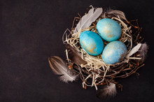 Easter Eggs In A Nest On Dark Background . Copy Space, Ester Holiday Postcard Concept.