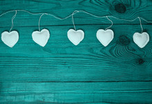 White Hearts On Turquoise Blue Duotone Color Wooden Background. Valentines Day Design Concept.Decorative Eco Linen Fabric Heart On Jute Twine Garland, Natural Retro Burlap Decoration Creative Flat Lay