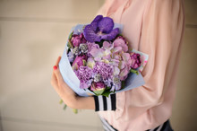 Woman Holding Blossoming Bouqu...