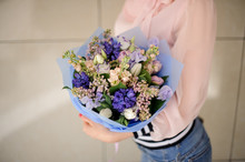 Woman Holding Blossoming Bouquet In Blue Tones In Her Hands.