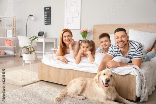 Fototapeta Happy family with dog in bedroom at home obraz