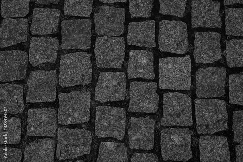 beautiful paving stones with grass as background