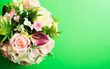 canvas print picture - bouquet of flowers from above on a green background. Free space for text