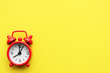 canvas print picture - Red alarm clock on a yellow bright background