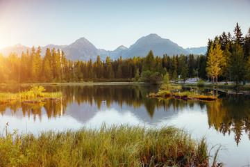 Panel Szklany Rzeki i Jeziora Calm mountain lake in National Park High Tatra. Location place Strbske pleso, Slovakia, Europe.