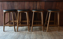 Row Of Wooden Chairs Or Stools...