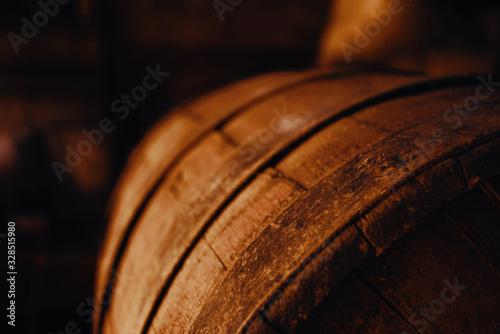 Cuadros en Lienzo Beer barrel close-up. Oak barrel texture