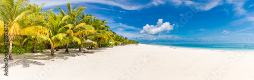 Beautiful tropical beach banner. White sand and coco palms travel tourism wide panorama background concept. Amazing beach landscape. Boost up color process. Luxury island resort vacation or holiday
