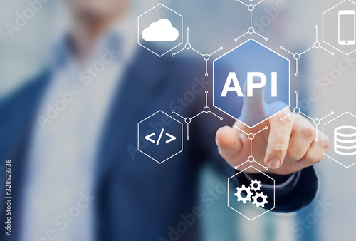 Obraz API Application Programming Interface connect services on internet and allow network data communication, software engineer touching concept for IoT, cloud computing, robotic process automation - fototapety do salonu
