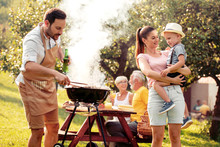 Family Makes Barbecue Together.