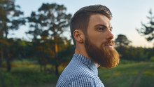 Portrait Brutal Bearded Hipster Man In The Forest Long Red Beard Blue Shirt Copy Free Space For Advertising