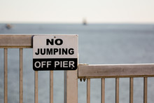 Sign With Text No Jumping Off Pier