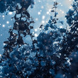 Blue floral background, blooming tree and flowers with snow and glitter for holidays