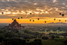 Sunrise Above Old Pagodas Misty With Amazing Clouds Early Morning And Air Balloons At Bagan, Myanmar.
