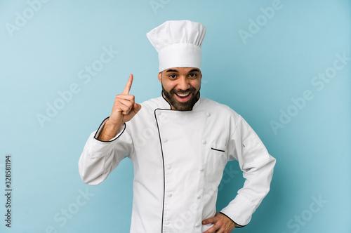 Fototapeta Young latin chef man isolated having an idea, inspiration concept. obraz