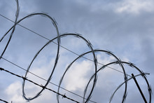 Barbed Wire On Blue Sky Backgr...
