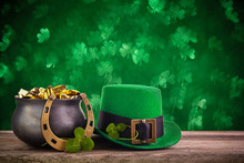 St Patrick's Day Hat And Pot With Gold Coins On Green Twinkling Bokeh Background