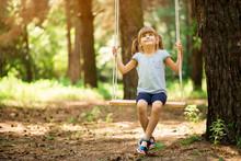Happy Little Girl On A Swing I...