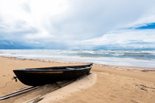 Old Wooden Boat On The Sandy C...