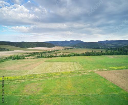 Fototapeta Scenic aerial view of beautiful landscape of the agrecultural valley obraz na płótnie