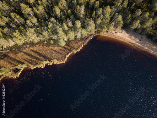 Aerial view of boggy lake shoreline with sandy beach Canvas Print