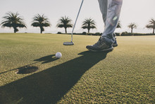 Golf Club And Ball In Grass At...