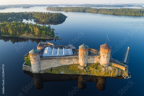 The ancient Swedish fortress Olavinlinna in the morning summer landscape (aerial photography) Canvas Print