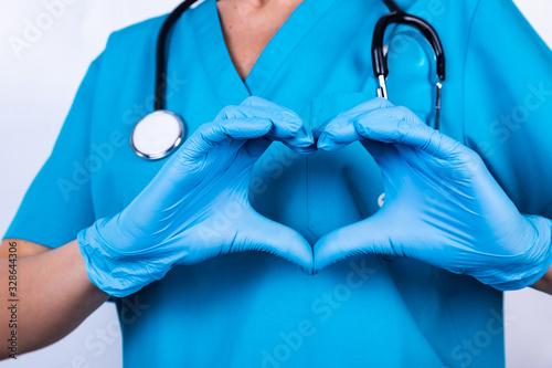Valokuvatapetti Doctor hands in gloves making heart shape