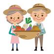 収穫した野菜を持つ農家の老夫婦