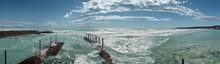 Panoramic View Of White Beach With Stormy Azure Waters Of Mediterranean Sea. Rosignano. Italy.
