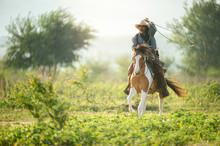 A Western Cowboy Riding A Hor...