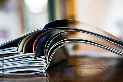 Cuadros en Lienzo Closeup background of a pile of old magazines with bending pages