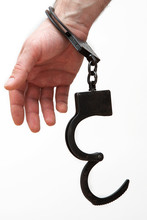 Handcuffed Hands Isolated On A...