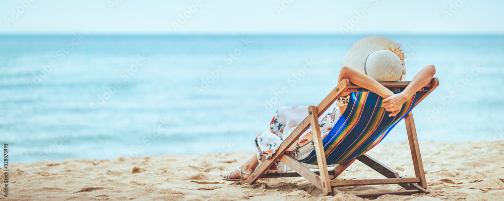 Fototapeta Woman on beach in summer